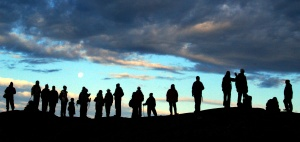Adventure travelers hike across