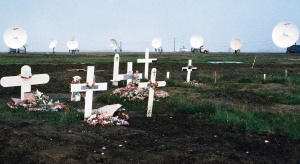 Cemetery in Barrow, Alaska with satellite dishes pointing low toward southern horizon