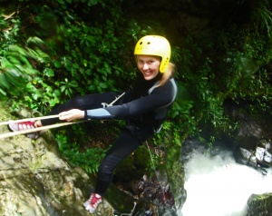 Co-canyoneer Laura McKiernan descends down the 100-foot waterfall near Merida, Venezuela